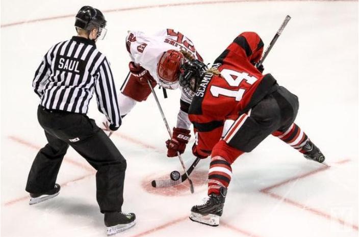 2 men playing hockey
